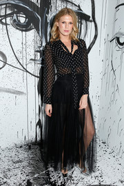 Alexandra Richards injected some shine with a pair of silver Mary Jane pumps, also by Dior.