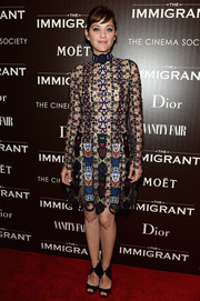 Marion Cotillard showed off her style credentials in a revealing lace Mary Katrantzou dress with embroidered badge print for the NYC premiere of 'The Immigrant'.
