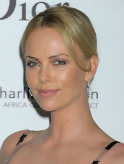 Charlize Theron pinned her hair up in a classic updo, which showed off her beautiful features.