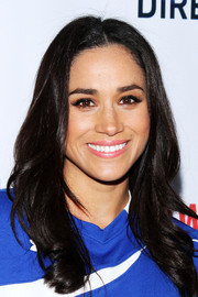 Meghan Markle looked sweet with her feathery waves at the DirecTV Celebrity Beach Bowl event.