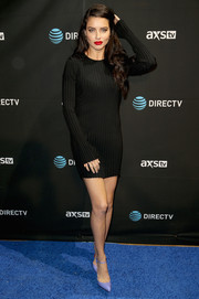 Adriana Lima went for a leggy look in a short black sweater dress by Elizabeth and James when she attended DirecTV Super Saturday Night.