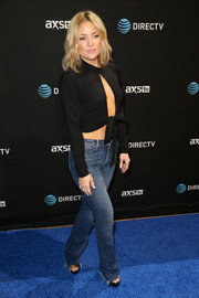 Kate Hudson teamed her sexy top with frayed blue jeans by Mother.