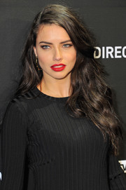 Adriana Lima wore her tresses loose in casual waves while attending DirecTV Super Saturday Night.
