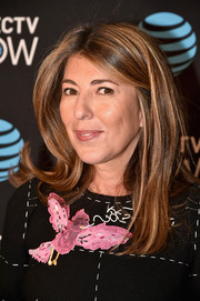 Nina Garcia sported a loose center-parted style while attending the DirecTV Now launch.