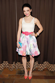 Leah Gibson looked fun and feminine at the premiere of 'Rogue' when she sported this watercolor-print dress with a fuchsia belt.