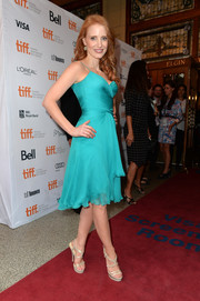 Jessica Chastain paired nude strappy sandals with a flirty cocktail dress for an ultra-feminine finish during the premiere of 'The Disappearance of Eleanor Rigby.'