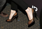Winona Ryder chose a pair of see-through pumps for her cool and contemporary evening look.