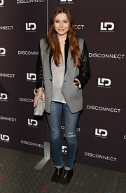 Elizabeth Olsen chose a gray blazer with leather sleeves and lapels for a cool mix of class and edge.