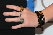 Miley Cyrus paired her casual look with a silver and turqouise gemstone ring.