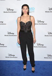 Roselyn Sanchez paired her top with black tuxedo trousers.
