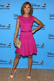 Toks kept it preppy chic with a hot fuchsia cap-sleeve dress with an adorable pleated skirt and bow belt.