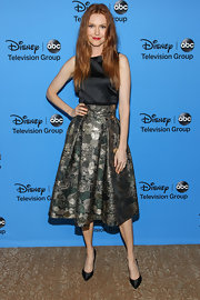 Darby wore this black and silver gilded frock with a full retro-style skirt.