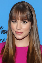 Christa brought out maximum shine with this sleek cut and sharp bangs.