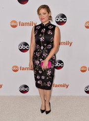 Erika Christensen's geometric pink satin clutch went perfectly with her dress.