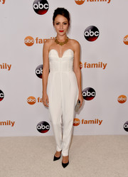 Italia Ricci looked effortlessly chic in a strapless white sweetheart-neckline jumpsuit during the Disney Group's Summer TCA Press Tour.