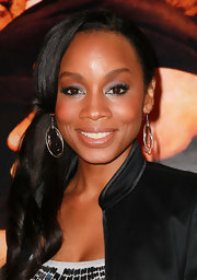 Anika Noni Rose wore shimmering silver  shadow to brighten her beautiful brown eyes at the 'Have a Little Faith' premiere.