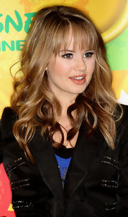 Debby styled her honey-hued locks into soft beach waves for the Disney & ABC summer press junket.
