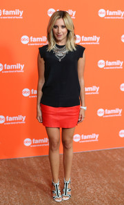 Ashley Tisdale completed her modern ensemble with a pair of black-and-white L.A.M.B. Noel sandals.