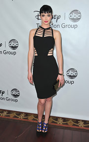 Krysten Ritter paired her cutout black dress with black pumps complete with cobalt detailing.