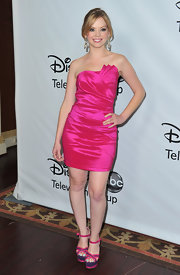 Dreama Walker was bold in pink at the TCA Winter Press tour. She accessorized the cocktail dress with platform color-blocked sandals.