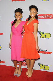Halle Bailey matched her sister, Chloe, in this citrus frock.