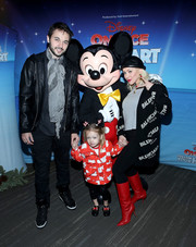 Christina Aguilera stayed warm in style with a black Balenciaga logo cardigan at the 'Disney on Ice: Follow Your Heart' event.