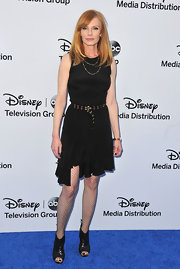 Marg Helgenberger's black dress featured an asymmetrical ruffled hem for a cool and quirky look at the Disney Media upfront event.