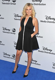 Malin rocked a black A-line with a front white zipper detail at the Disney Media Upfront in Burbank.