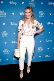Hilary Duff kept it casual yet cute in a short-sleeve print blouse by Christine Alcalay at D23 Expo.