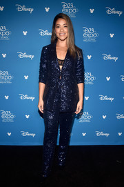 Gina Rodriguez sparkled in a navy sequined pantsuit by Ellie Mae Studios at D23 Expo.