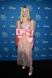Elle Fanning couldn't be missed at the Disney Studios Showcase Presentation wearing this bow-adorned pink shirtdress by Kimhekim.