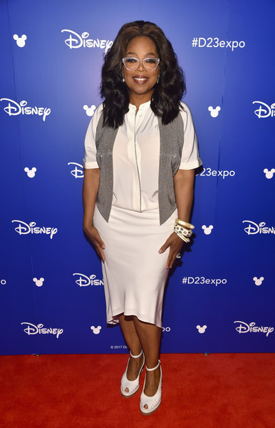 For her footwear, Oprah Winfrey chose a pair of white ankle-strap peep-toes.