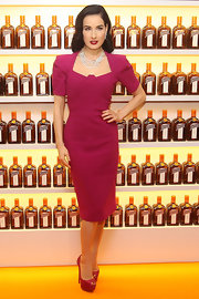 Dita Von Teese paired her pretty berry dress with matching platform peep-toe pumps.
