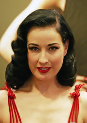 Dita Von Teese created her retro eye look at the launch of her Muse collection with lots of black liquid liner and super long false lashes