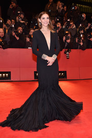 Clotilde Courau looked divine in a black Stephane Rolland Couture mermaid gown with a down-to-the-navel neckline at the Berlinale premiere of 'Django.'