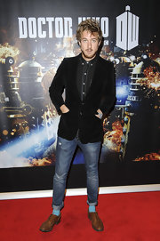 Arthur Darvill gave a glimpse of his quirky style with a pop of color from his light blue socks.