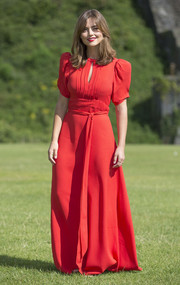 Jenna-Louise Coleman kept it demure and ladylike in a red gown with a keyhole neckline and puff sleeves during 'Doctor Who' Cardiff premiere.
