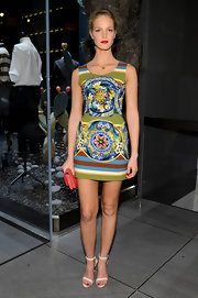 Erin Heatherton chose a printed mini dress for a bold and vibrant look at the 5th Avenue opening of Dolce & Gabbana.