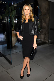 Stacy rocked a cropped leather jacket with her standard black dress.