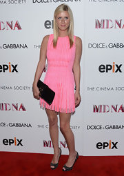 Nicky Hilton looked pretty in pink when she sported this sleeveless, lace frock with pleats.