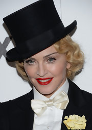 Madonna sported a crisp and bold red lip to add a feminine touch to her menswear look.