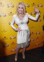 Dolly Parton paired her dress with PVC platform sandals.