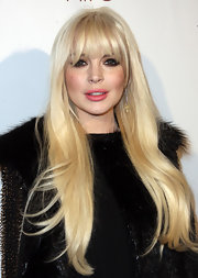 Lindsay Lohan attended the Domingo Zapata Oscar Art Show wearing her ultra-long hair with lash-grazing bangs.