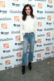 Hilary Rhoda cozied up in a diamond-patterned sweater for her visit to the Domino Holiday Pop-Up Shop.