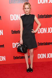 Dakota Johnson teamed her dress with modern-chic peep-toe pumps.