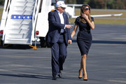 Melania Trump attended a campaign rally wearing a simple short-sleeve navy dress.