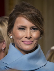 Melania Trump's pink lipstick worked beautifully with her blue outfit.