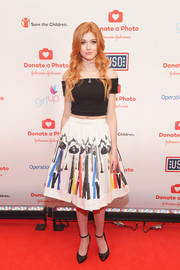 Katherine McNamara's painterly-print skirt and off-the-shoulder top were an adorably chic pairing.