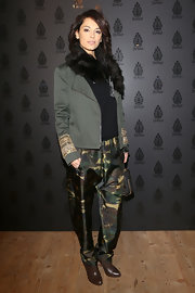 Girogia Surina glammed up camouflage with a classic fur scarf at Milan Fashion Week.