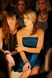 Ashley sat front row and showed off her silver bangle bracelets at the Donna Karan fashion show.